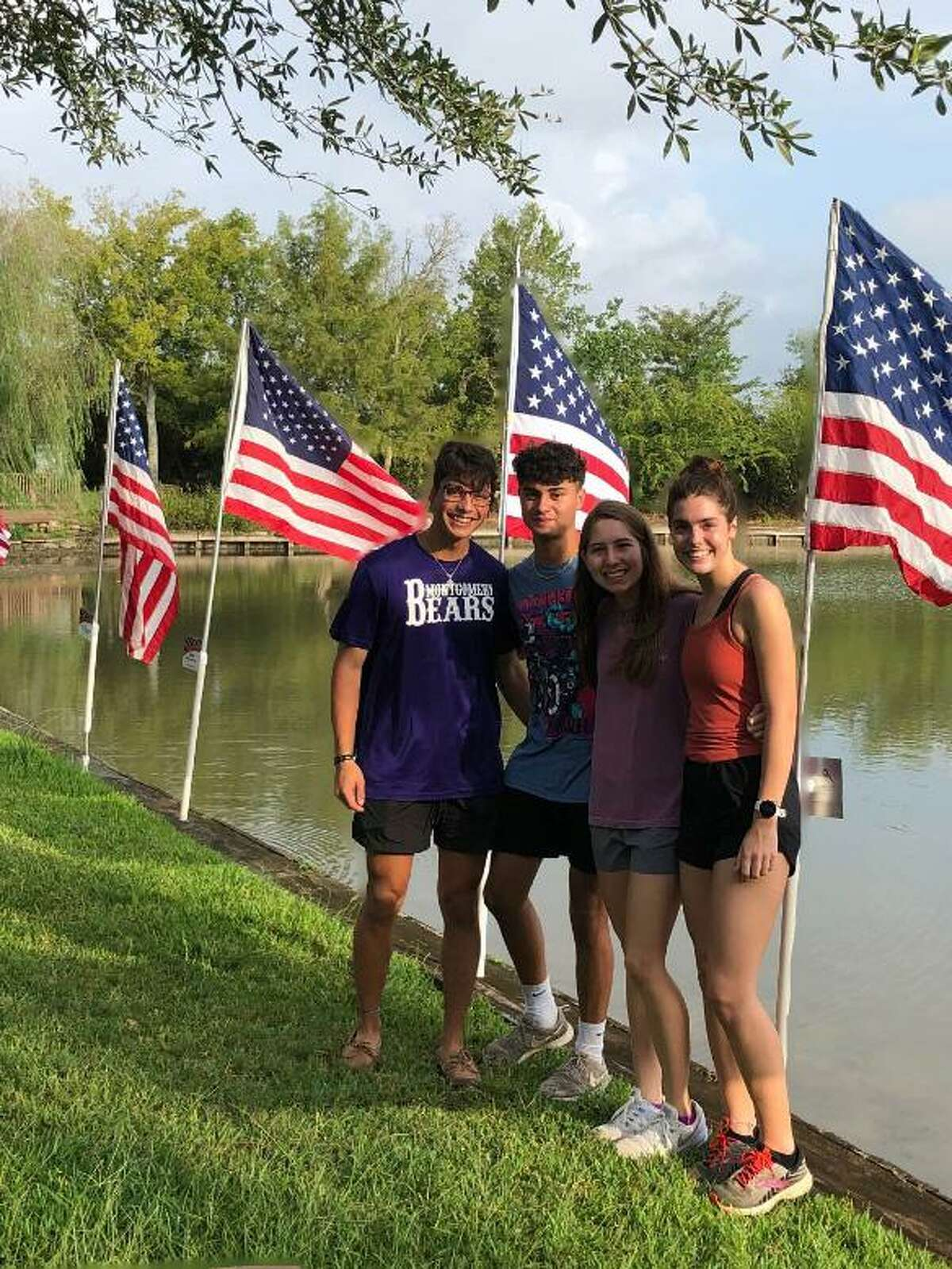 Interact students set flags at Memory Park in Montgomery. The flags are placed at the park to recognize national holidays.
