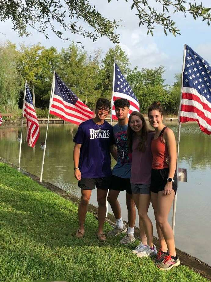 Interact students set flags at Memory Park in Montgomery. The flags are placed at the park to recognize national holidays. Photo: Courtesy Photo