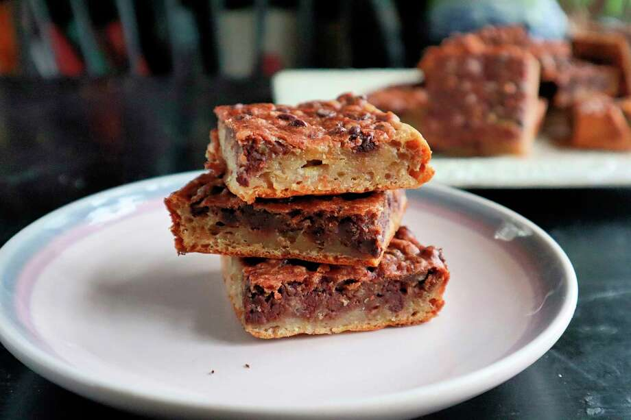 Banana bread teams up with chocolate chips and oatmeal to create a layered brownie that's just as good for breakfast as it is dessert. (Gretchen McKay/TNS) / Pittsburgh Post-Gazette