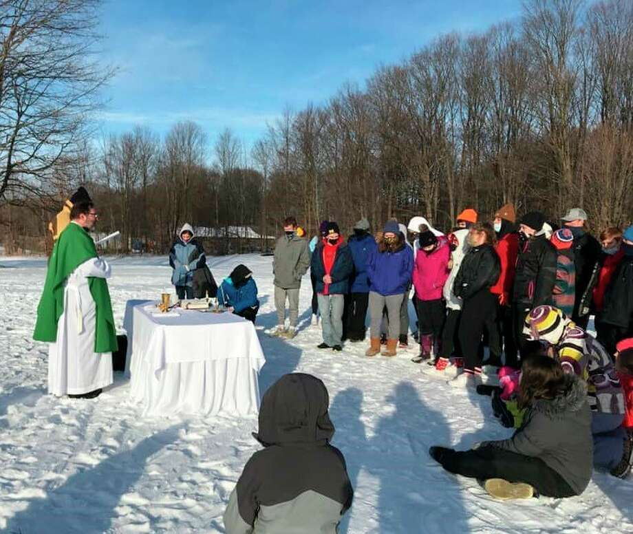 Manistee Catholic Central students in grades six through 12 attend an outdoor Mass at Crystal Mountain Monday before a day of skiing as part of the school's Catholic Schools Week celebration. (Courtesy photo)