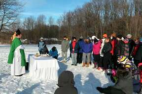 Manistee Catholic Central students in grades six through 12attend an outdoor Mass at Crystal Mountain Monday before a day of skiing as part of the school's Catholic Schools Week celebration. (Courtesy photo)