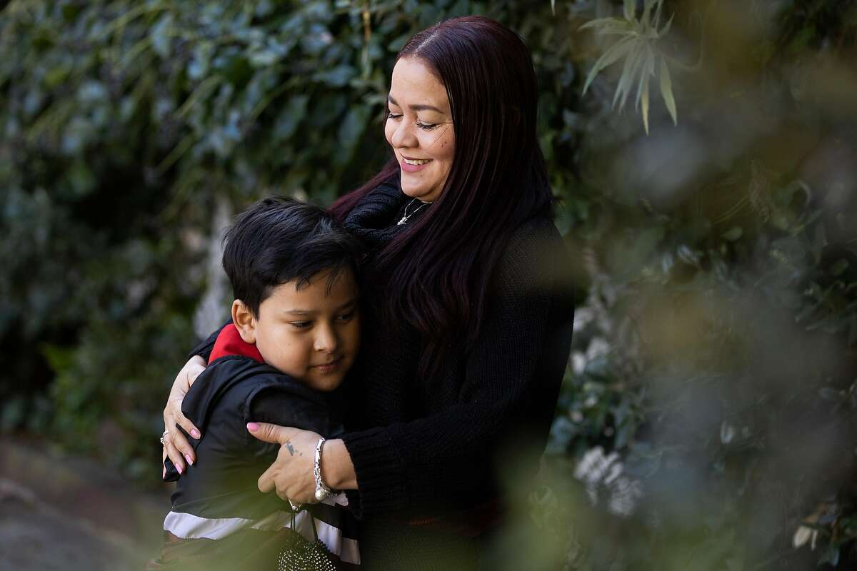 Victoria Vega, shown with her son Bryant Aleman, struggled for months to apply for unemployment benefits in Spanish. A budget proposal would increase EDD's ability to help the 7 million Californians who speak a language other than English.