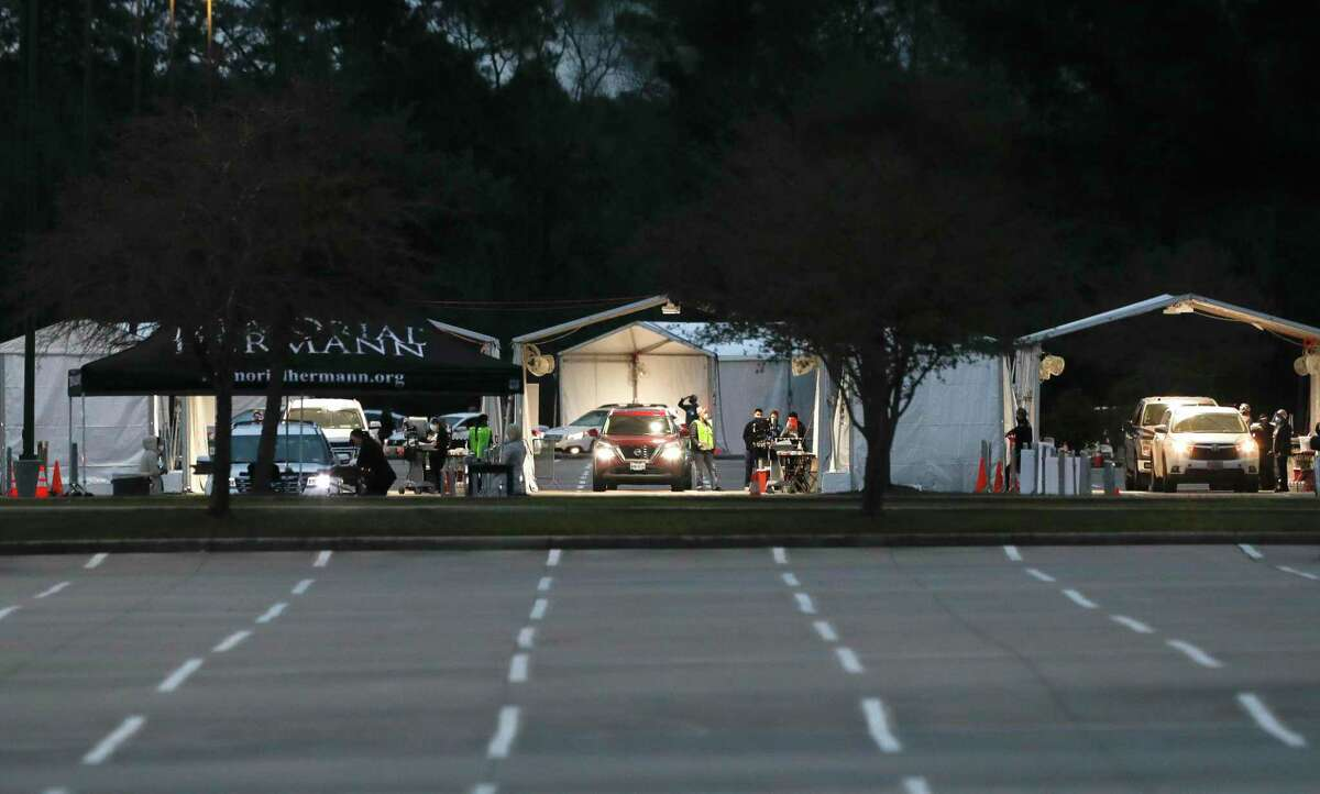 Montgomery County residents take part in a mass drive-thru COVID-19 vaccination site at Woodforest Bank Stadium, Friday, Feb. 5, 2020, in Shenandoah. The site is the county's third vaccination site.