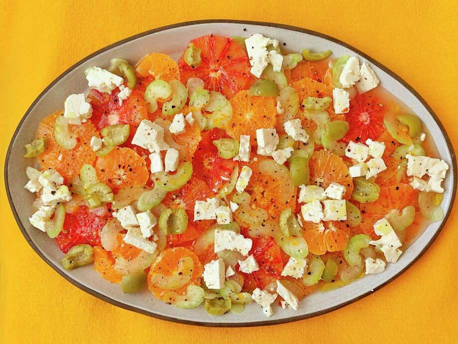 Feta, celery and green olives add just the right amount of saltiness to a salad of sweet orange citrus. (Ben Mims/TNS)