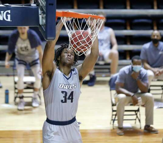 Rice Owls forward Mylyjael Poteat (34) dunks the ball during the second half of an NCAA men's basketball game at Tudor Field House in Houston, Friday, Feb. 5. Photo: Karen Warren, Staff Photographer / © 2021 Houston Chronicle