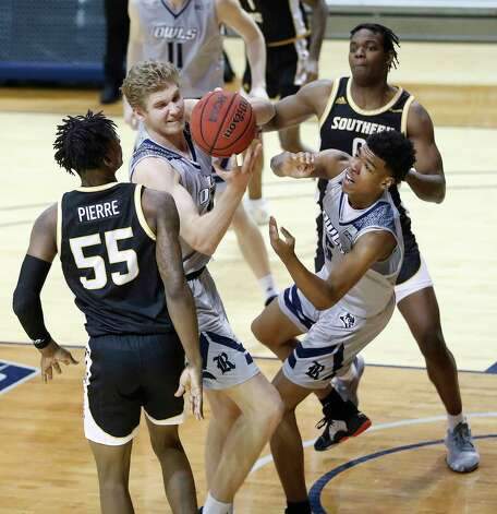 Rice Owls forwards Max Fiedler (15) and Cameron Sheffield (5) reach for a rebound against Southern Miss Golden Eagles guard Jaron Pierre Jr. (55) during the second half of an NCAA men's basketball game at Tudor Field House in Houston, Friday, Feb. 5. Photo: Karen Warren, Staff Photographer / © 2021 Houston Chronicle