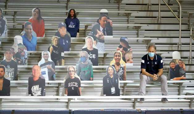 A man sits among the cardboard cutouts in the stands during the second half of an NCAA men's basketball game at Tudor Field House in Houston, Friday, Feb. 5. Photo: Karen Warren, Staff Photographer / © 2021 Houston Chronicle