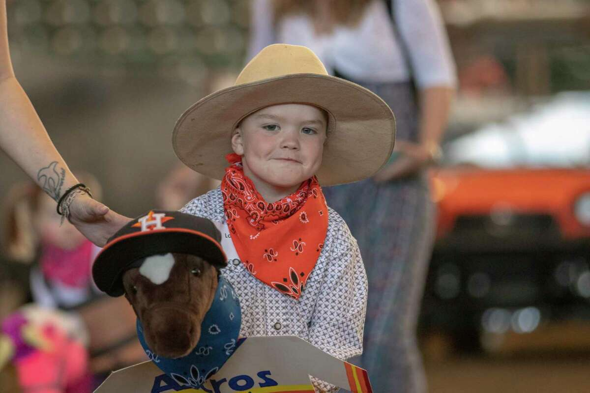 Stick horse racer Lane Brett entered the arena with his Astros decorated horse before the Youth Events at the Montgomery County Fair & Rodeo on March 29, 2019, in Conroe. The Montgomery County Fair Association confirmed Friday that it still plans to move forward with all events and activities scheduled for April 9-18, except for the annual the Senior Citizens Day assembly.