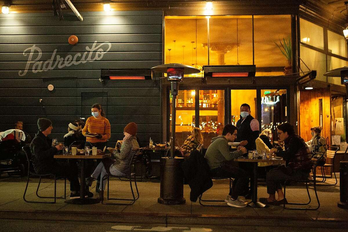 Padrecitos serves patrons outdoors in San Francisco, which reached the red tier of the state's guidelines this week.