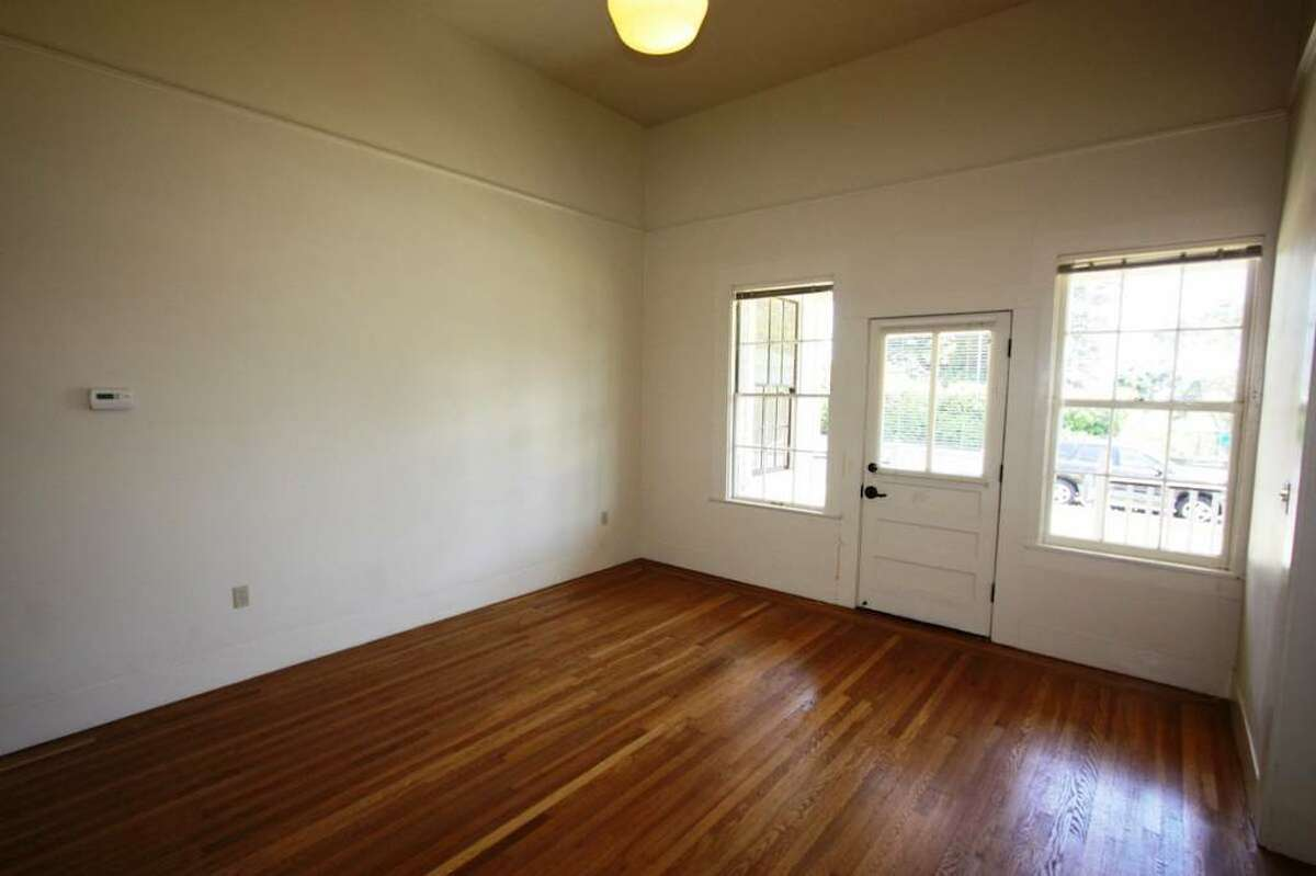 There's a large living area and a formal dining room, according to the listing.