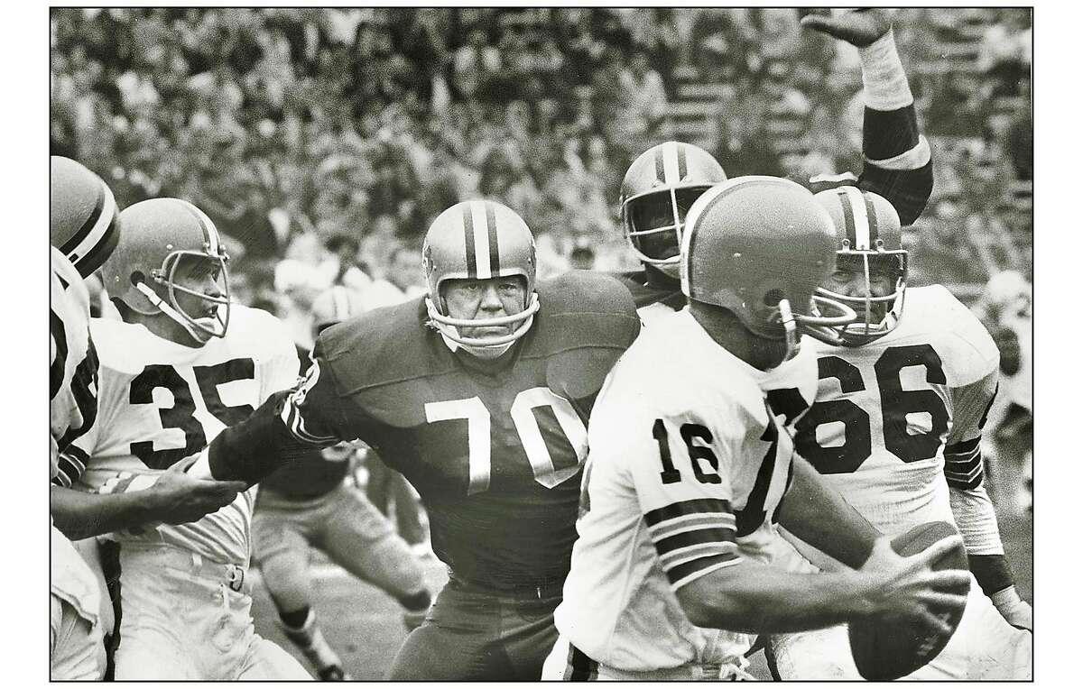 Niners defensive tackle Charlie Krueger closes in on Browns quarterback Bill Nelson at San Frabncisco's Kezar Stadium in 1968.