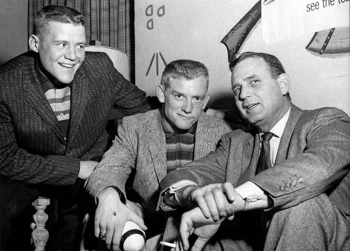 """12/05/1957 - Texas A&M Aggie football players Charlie Krueger, left, and John David Crow, center, pose with their coach, Paul """"Bear"""" Bryant, Dec. 5, 1957, during a stop in New York City to receive All American honors from Look Magazine. Both Krueger and Crow have been selected for the Associated Press All American Team. (AP Photo)"""