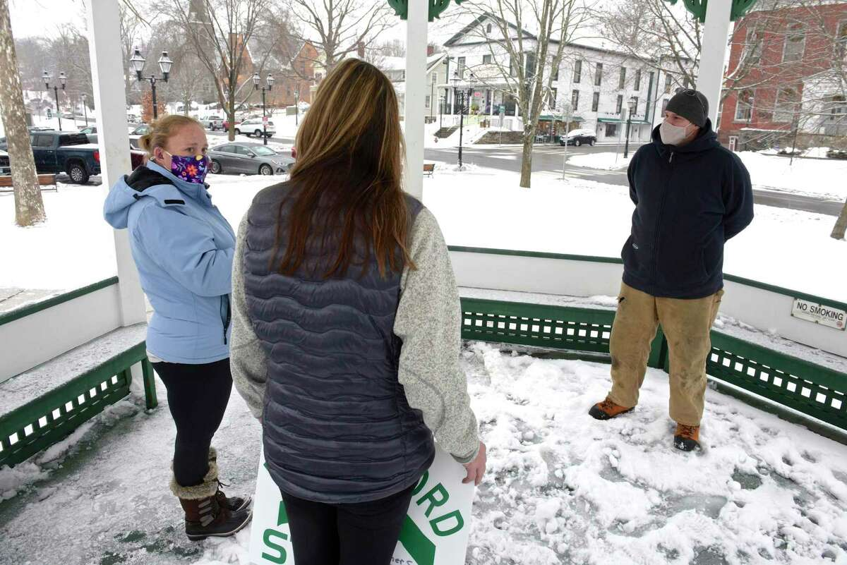 Joe, right, and Meredith Quaranta, center, with Jennifer Hauschild, left, of New Milford. Hauschild has been asking for important virtual town meetings be accessible for those who are deaf or hearing impaired like herself. Joe Quaranta, a friend and neighbor, brought up the issue at the New Milford town meeting. Friday, February 5, 2021, in New Milford, Conn.
