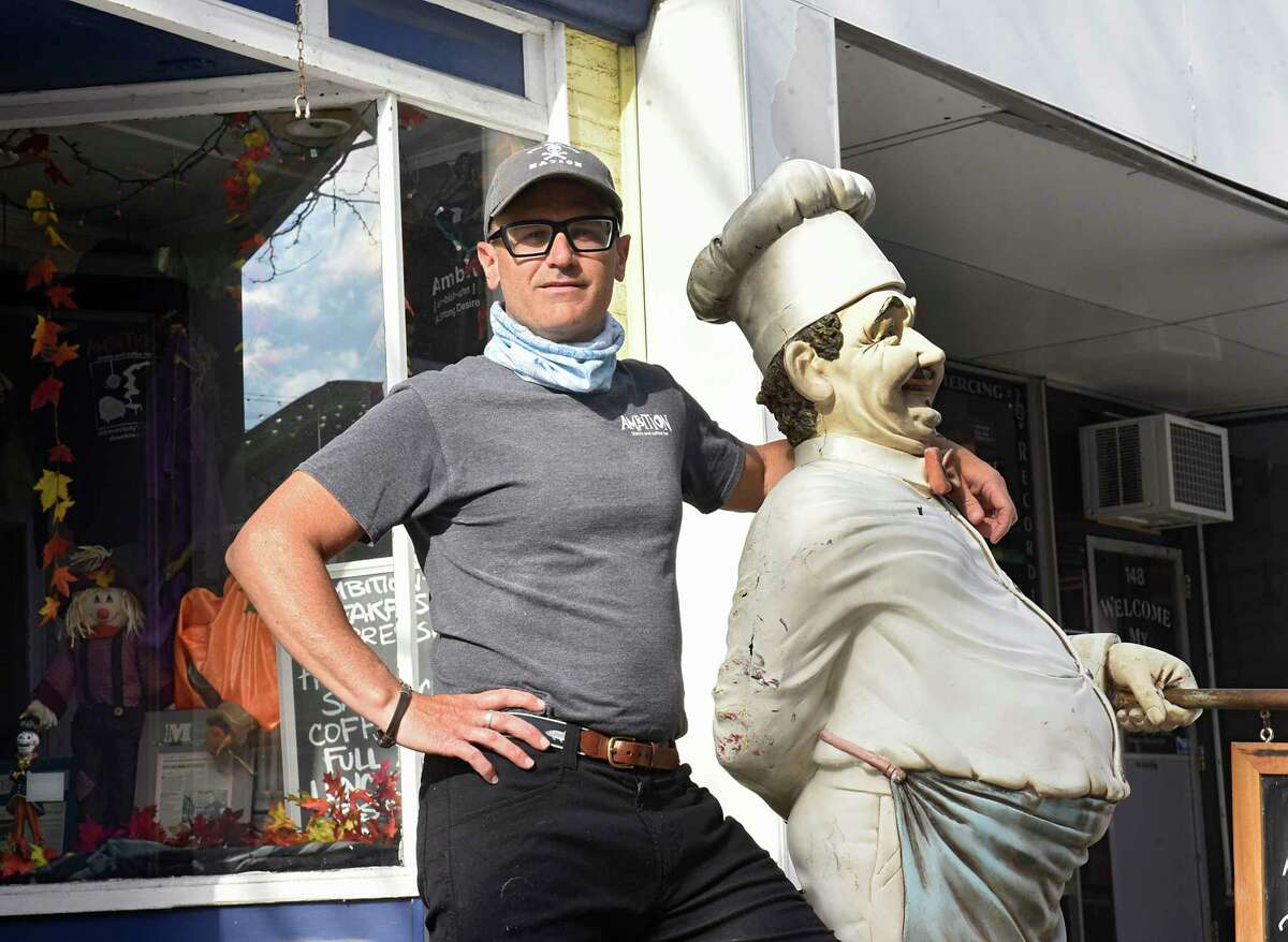 Ambition Eatery & Cafe owner Marc Renson stands in front of his business on the Jay Street Marketplace on Friday, Feb. 5, 2021 in Schenectady, N.Y. (Lori Van Buren/Times Union)
