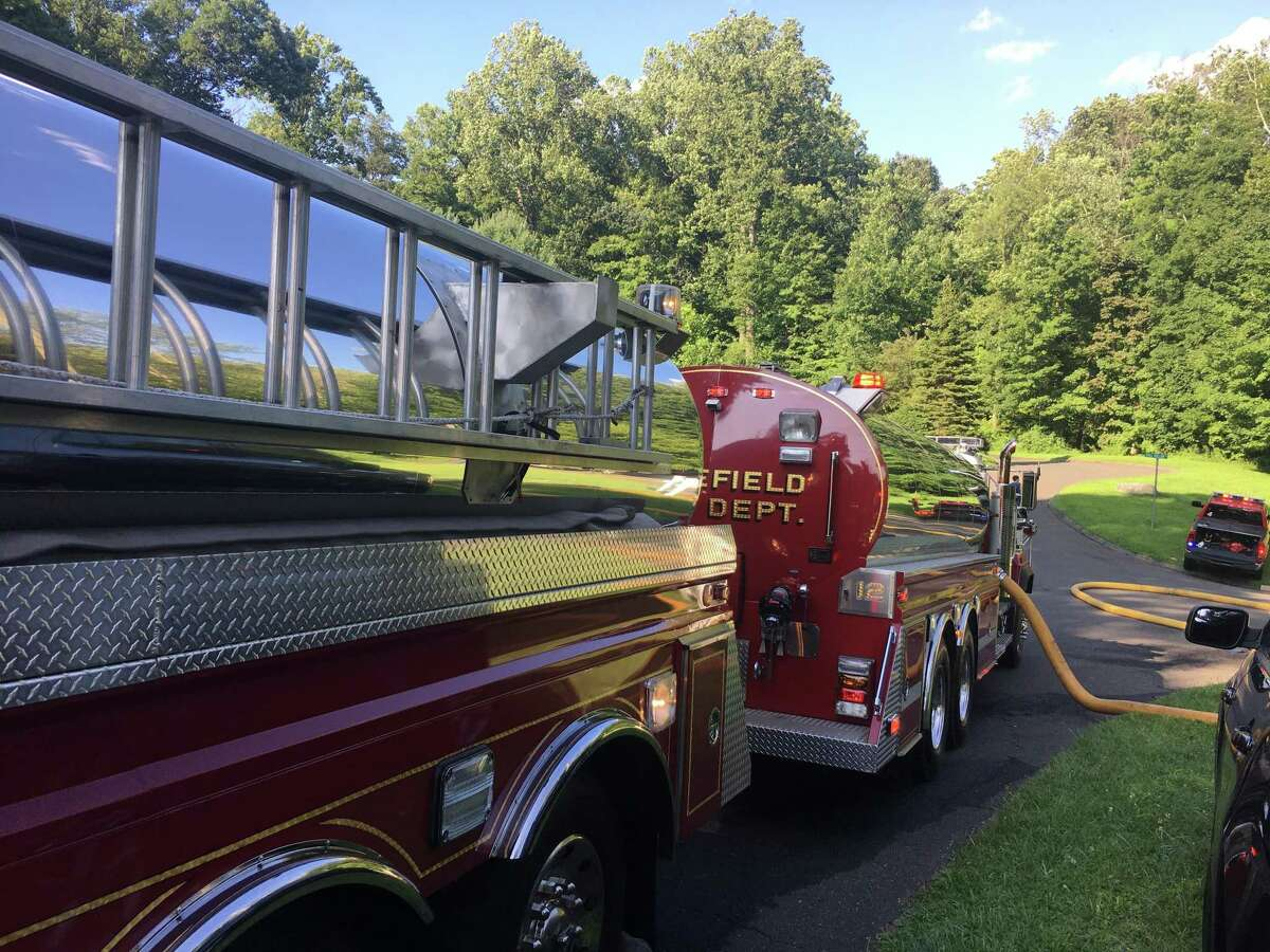 Ridgefield Fire department at the scene of a garage fire Thursday, Aug. 8