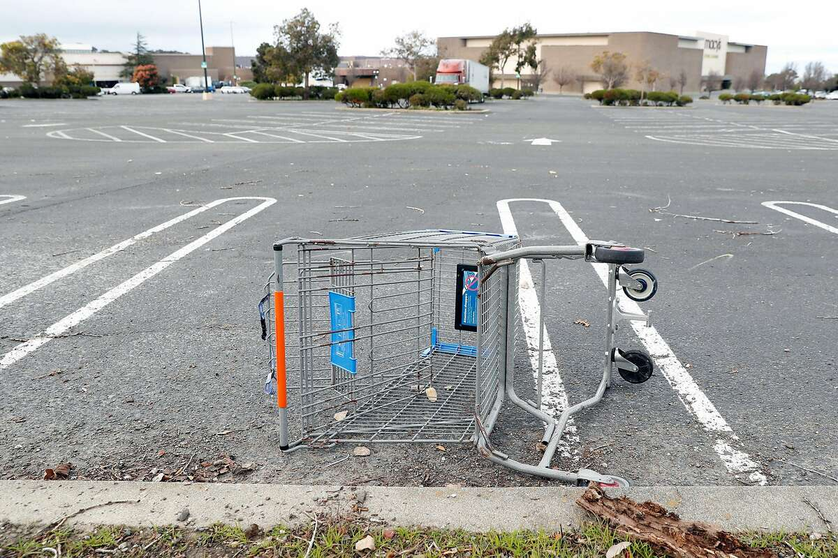 A discarded Wal-Mart shopping cart at The Shops at Hilltop in Richmond, Calif., on Monday, February 1, 2021.