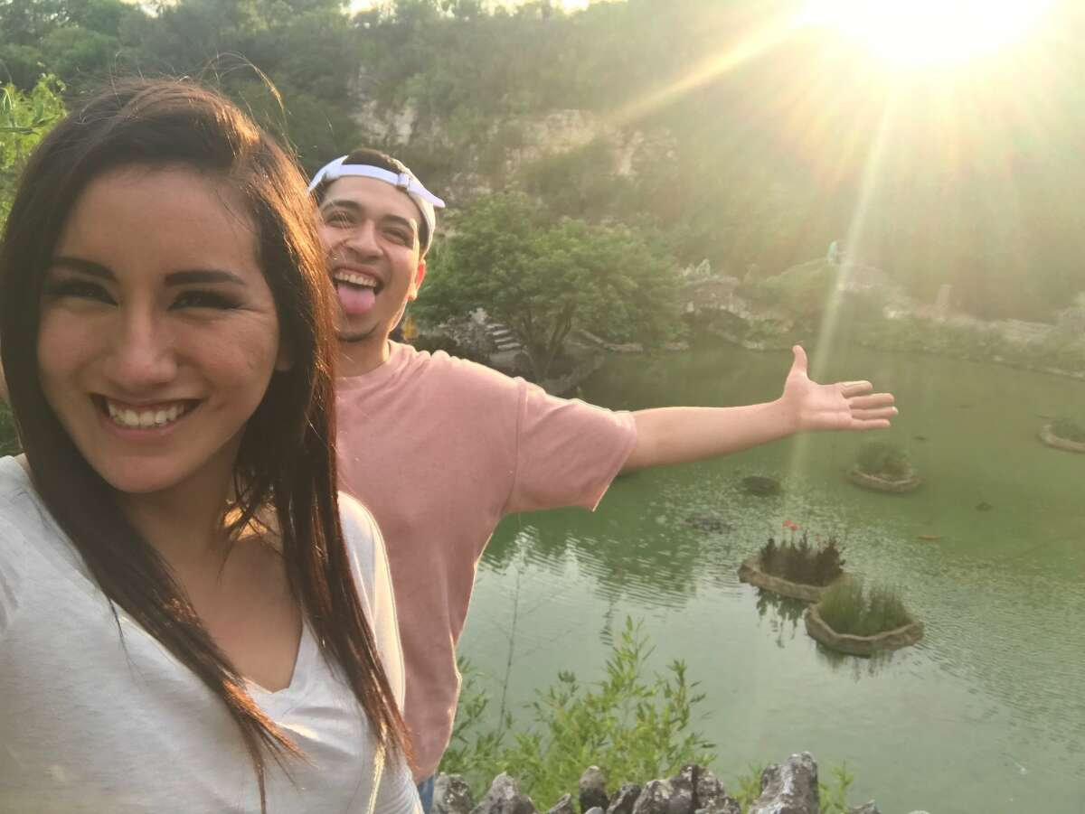 """""""Our first date was a trip to H-E- Bwhere we bought wine and snacks for a picnic. Then we went to Brackenridge Park where we had food and drinks overlooking the low water crossing bridge.The date ended with a scenic walk at Japanese Tea Gardens."""" - Julia Aguillon on falling for Luis Cerros"""