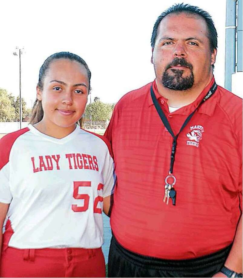 Martin High School softball head coach Greg Garcia and his daughter Hermione. Photo: Cuate Santos / Laredo Morning Times