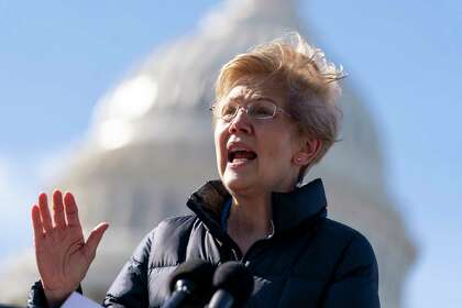 """Sen. Elizabeth Warren, D-Mass., speaks at a news conference on Capitol Hill in Washington, Thursday, Feb. 4, 2021. On Jan. 27, 2021, she said that """"for years, the same hedge funds, private equity firms, and wealthy investors dismayed by the GameStop trades have treated the stock market like their own personal casino while everyone else pays the price."""""""