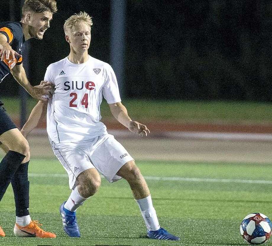 SIUE's Oskar Lenz, right, converted a penalty kick 33 seconds into the second overtime period, lifting the Cougars to a 2-1 victory over Butler University in the delayed season opener Friday at the indoor Grand Park sports complex in Westfield, Ind. Lenz is shown in action last season. Photo: SIUE Athletics