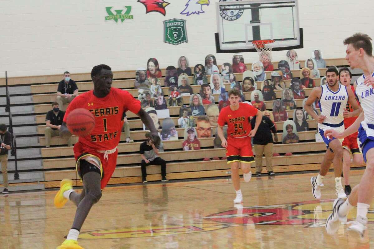 Ferris State's Deng Reng (1) leads the charge down the court. (Pioneer photo/John Raffel)