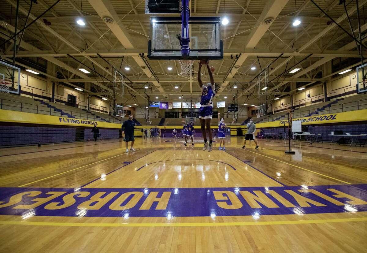 The Troy High School boys basketball team during a practice at Troy High School as the team prepares for a shortened season on Thursday, Feb. 4, 2021 (Jim Franco/special to the Times Union.)