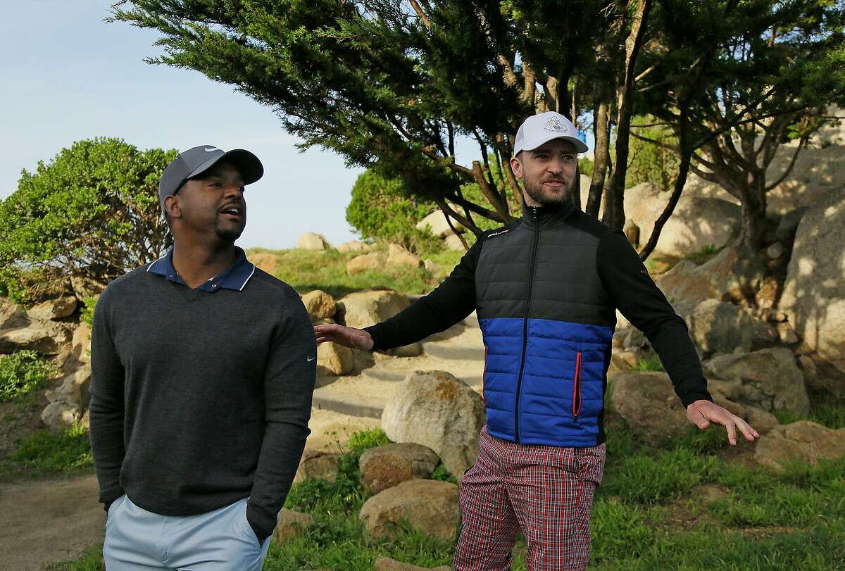 Justin Timberlake, right, tells fans that it is too early for Alfonso Ribeiro, left, to act and dance after putting on the 10th green of the Monterey Peninsula Country Club Shore Course during the second round of the AT&T Pebble Beach National Pro-Am golf tournament Friday, Feb. 12, 2016, in Pebble Beach, Calif. (AP Photo/Eric Risberg)