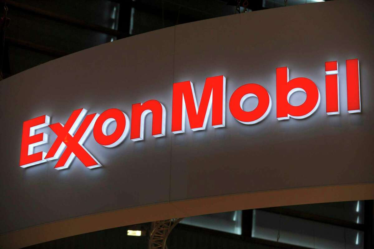 (An activist investor won two seats on the board of Exxon Mobil, delivering a sharp rebuke to the nation's largest oil company over its climate change policies.