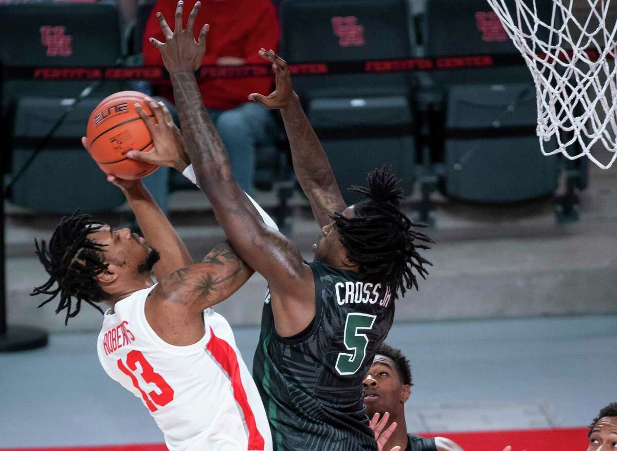 J'Wan Roberts, trying to get his shot off against Tulane earlier in the season, will be one of the Cougars getting extra work against Our Lady of the Lake on Saturday.