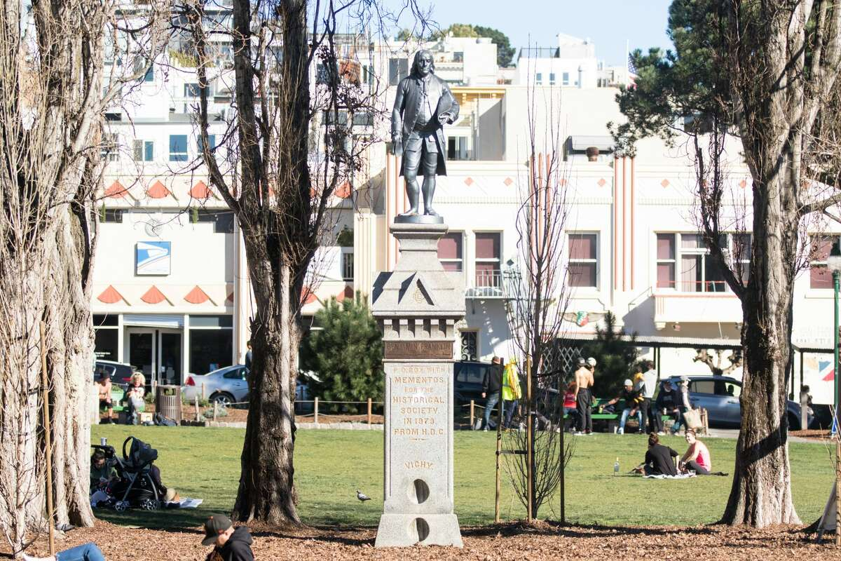A statue of Benjamin Franklin is seen in the center of Washington Square Park in San Francisco on Feb. 5, 2021. In the pedestal of the statue is a time capsule that was place inside in 1979 and will be opened in 2079.