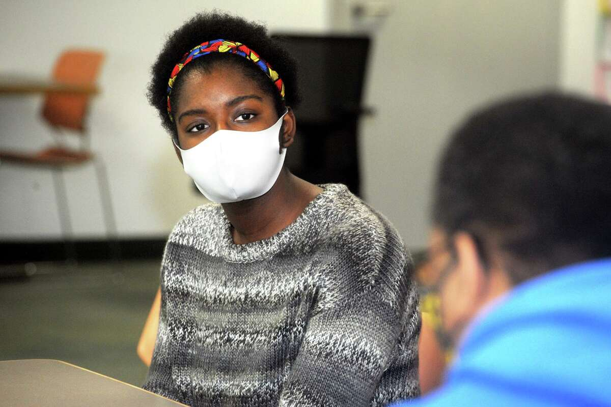 Samantha Samuel, a junior from AITE High School, speaks during the meeting on Friday.