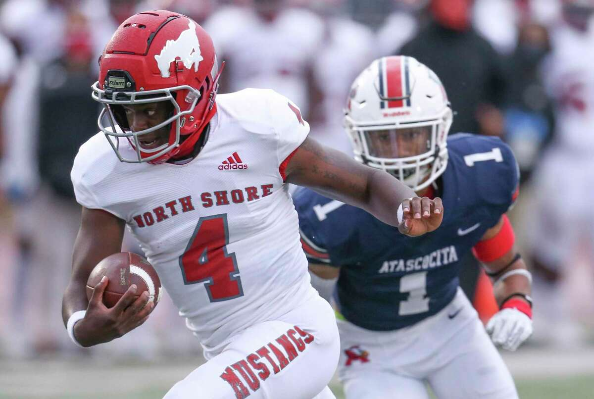 North Shore Mustangs quarterback Dematrius Davis (4) rushes for a touchdown against Atascocita Eagles cornerback Jordan Augustine (1) in the first quarter in a high school football game on November 27, 2020 at Turner Stadium in Humble, TX.