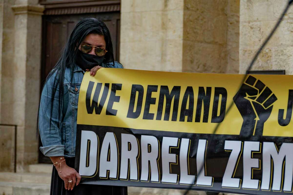 A woman attends a vigil to remember Darrell Zemault in Main Plaza on Friday, Feb. 5, 2021. Zemault was killed by police on Sept. 15, 2019, in front of his West San Antonio home.
