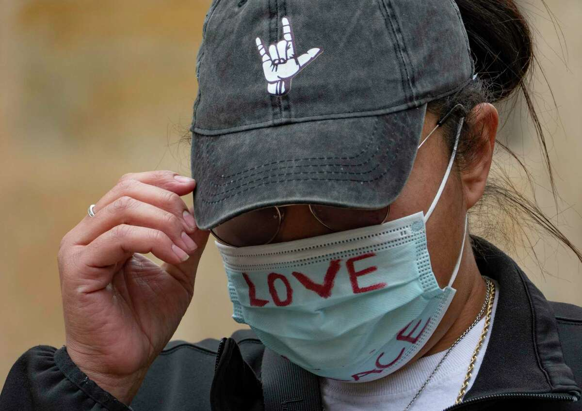 Melissa Zemault Wicker wears a mask during a vigil to remember her father, Darrell Zemault, in Main Plaza on Friday, Feb. 5, 2021. Zemault was killed by police on Sept. 15, 2019, in front of his West San Antonio home.