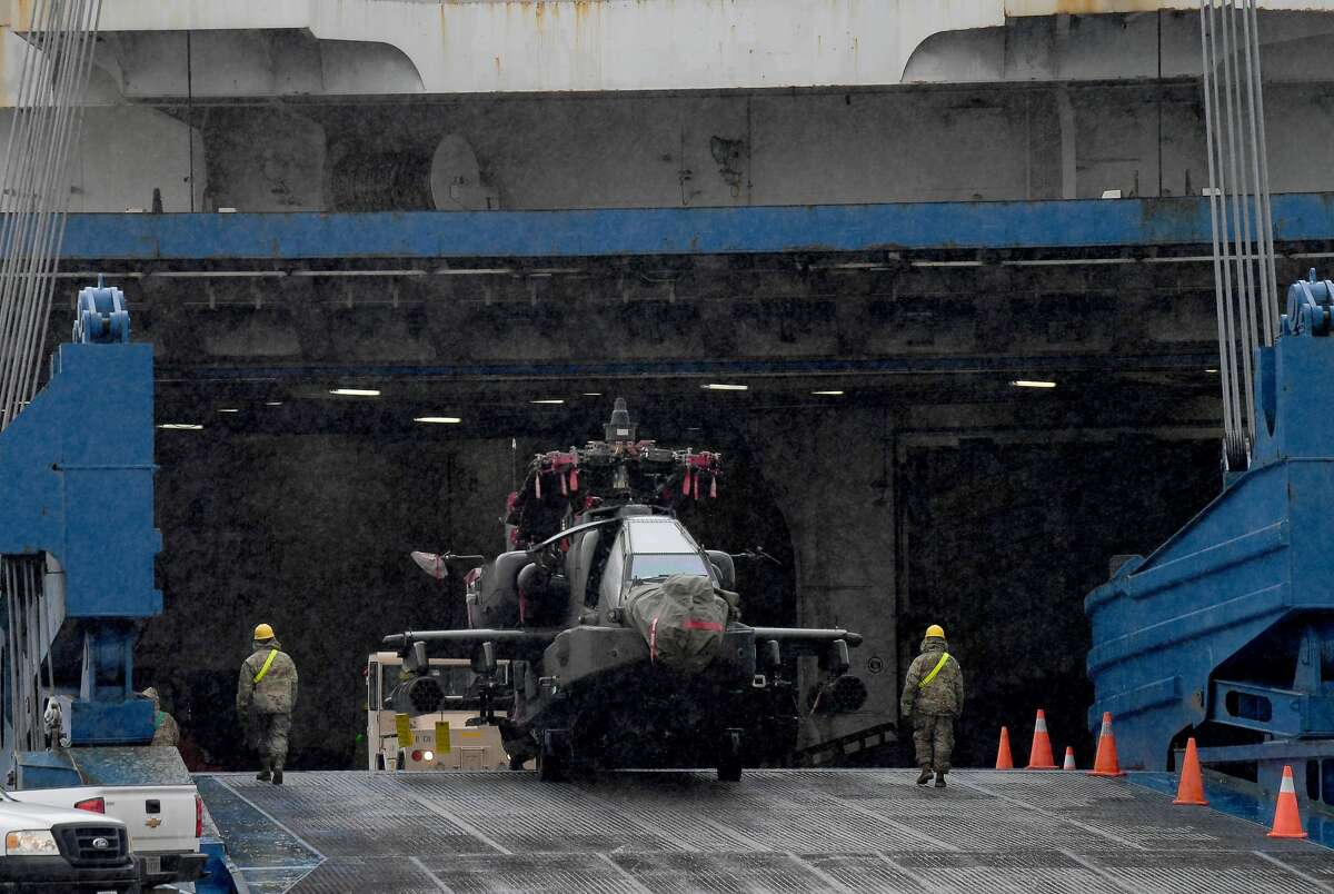 Members of the 842nd Transportation Battalion load helicopters and other military vehicles onto a vessel docked at the Port of Beaumont. The cargo is bound for Europe to be used in military training with NATO allies. A second vessel arrives Monday to transport the remaining cargo from the port. Photo taken Thursday, February 4, 2021 Kim Brent/The Enterprise