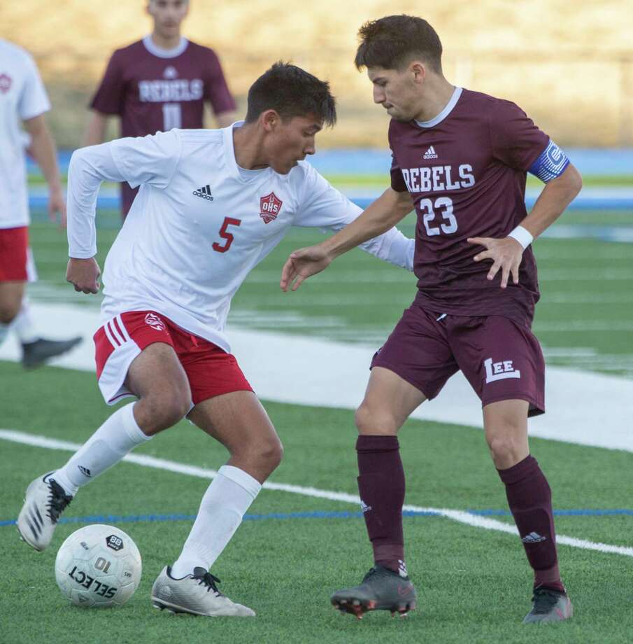 Lee High's Alexis Guevara defends as Odessa High's Jr Mora tries to get around him 02/05/2021 at Grande Communications Stadium Tim Fischer/Reporter-Telegram Photo: Tim Fischer, Midland Reporter-Telegram