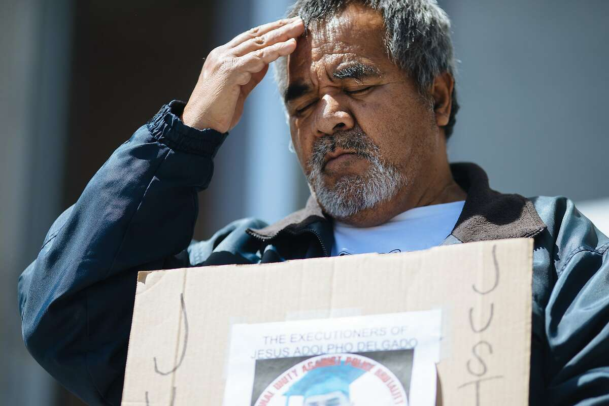 Jose Delgado, whose son Jesus Adolfo Delgado-Duarte was killed in a shootout with police, takes part in a protest in April 2018 against police shootings.
