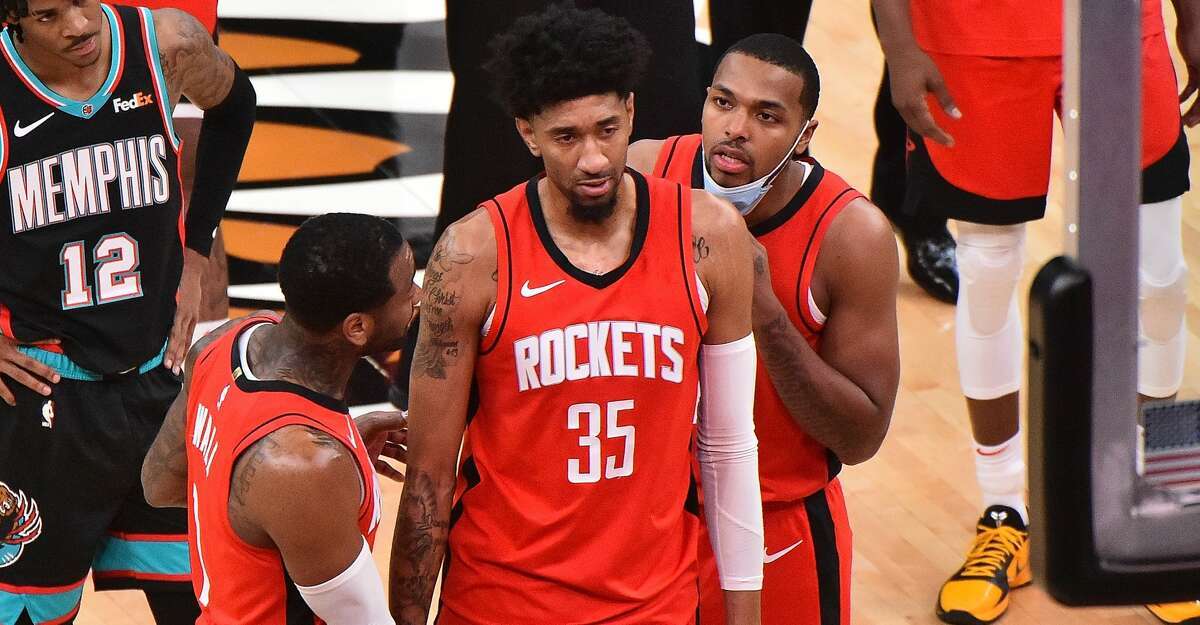 Christian Wood #35 of the Houston Rockets reacts after a injury during the second half against the Memphis Grizzlies at FedExForum on February 04, 2021 in Memphis, Tennessee. (Photo by Justin Ford/Getty Images)