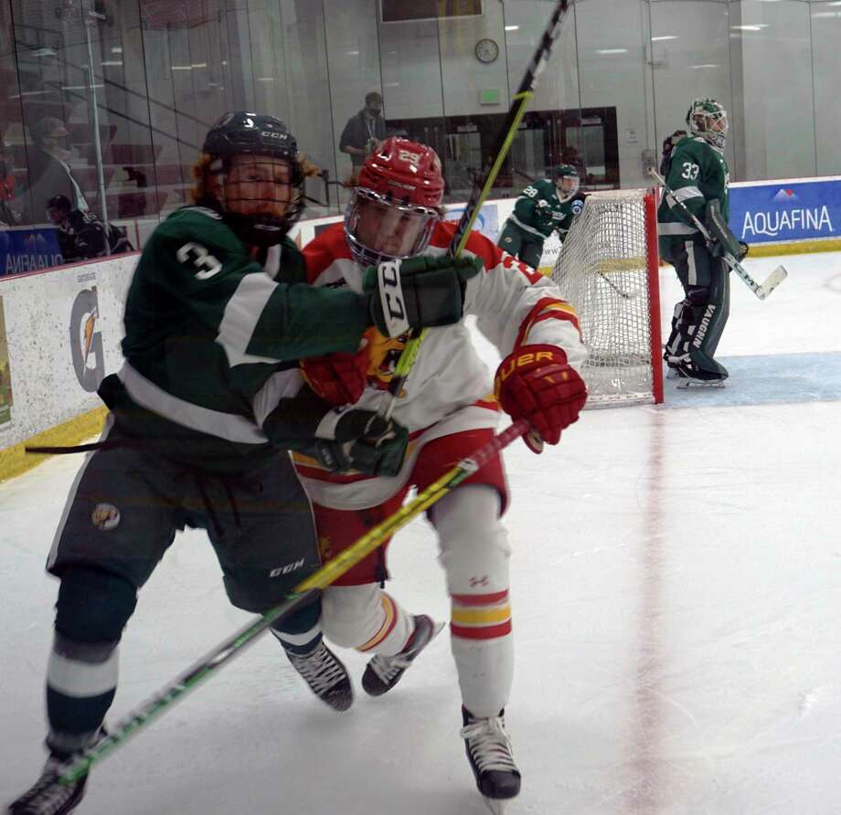 Ferris State junior Ethan Stewart (right) and Bemidji State freshman Jack Powell collide during Friday night's game at Ewigleben Ice Arena. (Pioneer photo/Joe Judd)