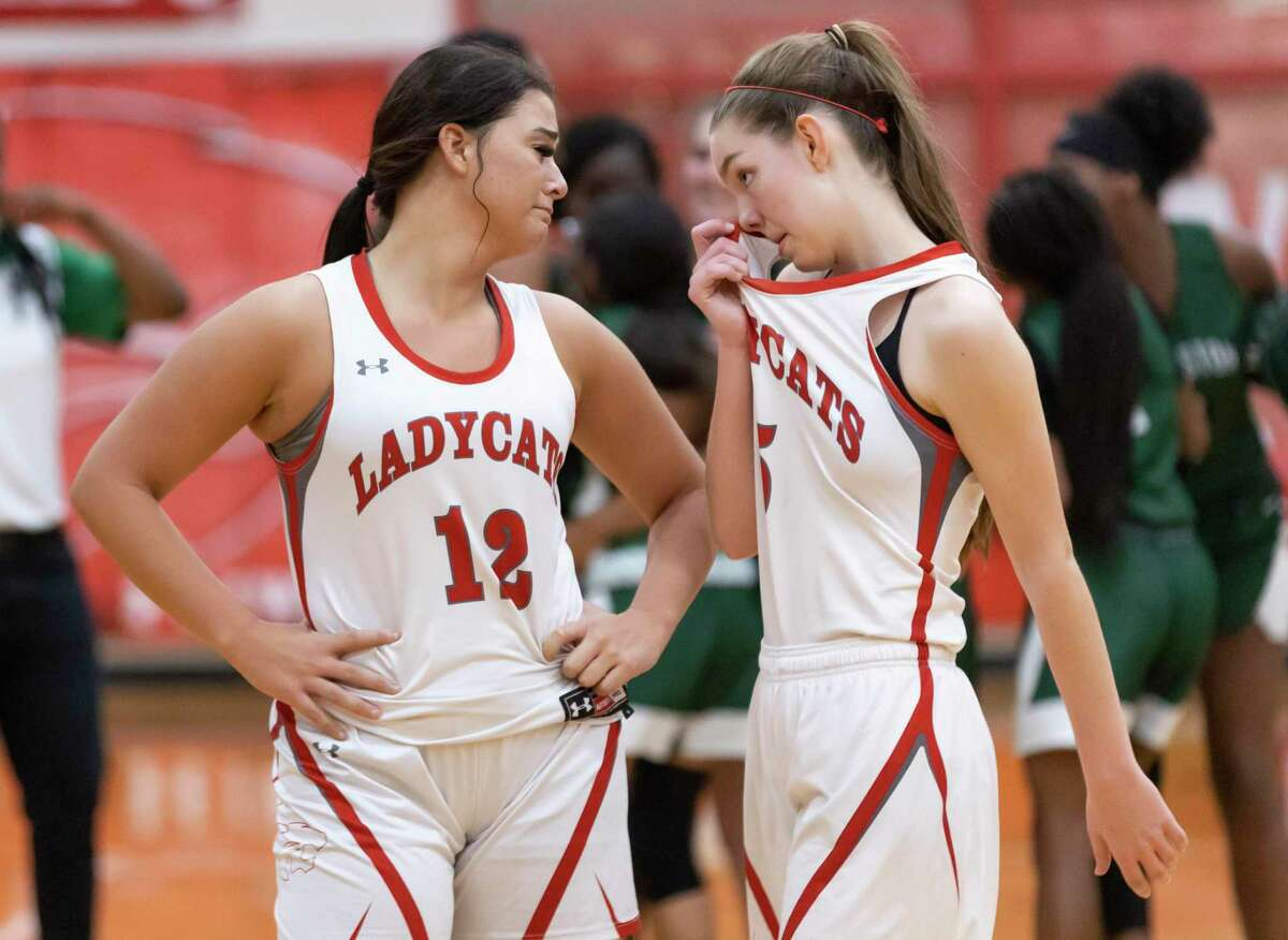 Splendora Mykala Moore (12) and Melaney Owens (5) react after they lose during overtime of a District 21-4A girls basketball game at Splendora High School, Friday, Feb. 5, 2021, in Splendora. Splendora will be out for the rest of the season.