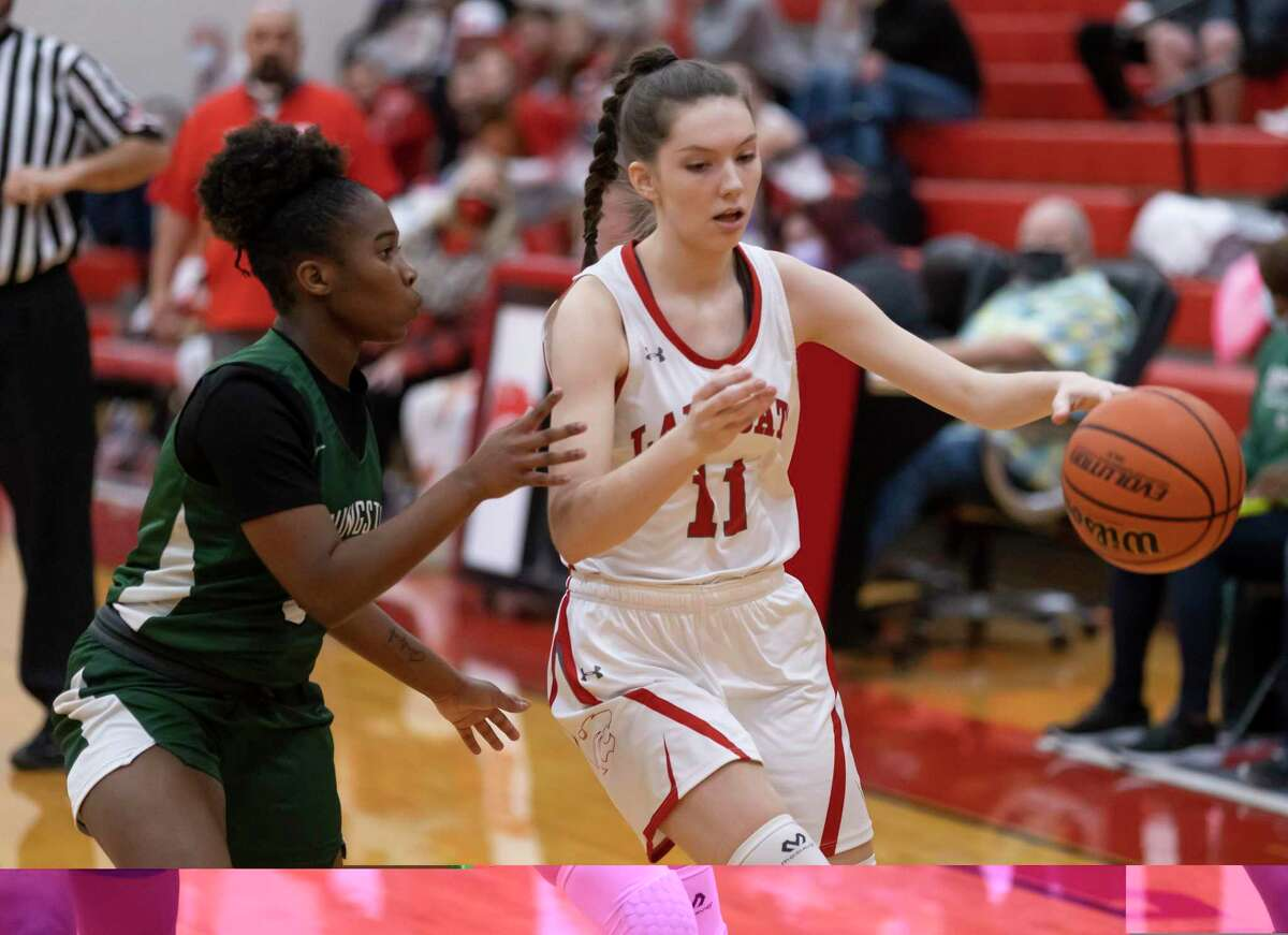 Splendora Bethany Owens (11) dribbles the ball down the court while under pressure from Livingston Kaaliyah Youngblood (3) during the first quarter of a District 21-4A girls basketball game at Splendora High School, Friday, Feb. 5, 2021, in Splendora.