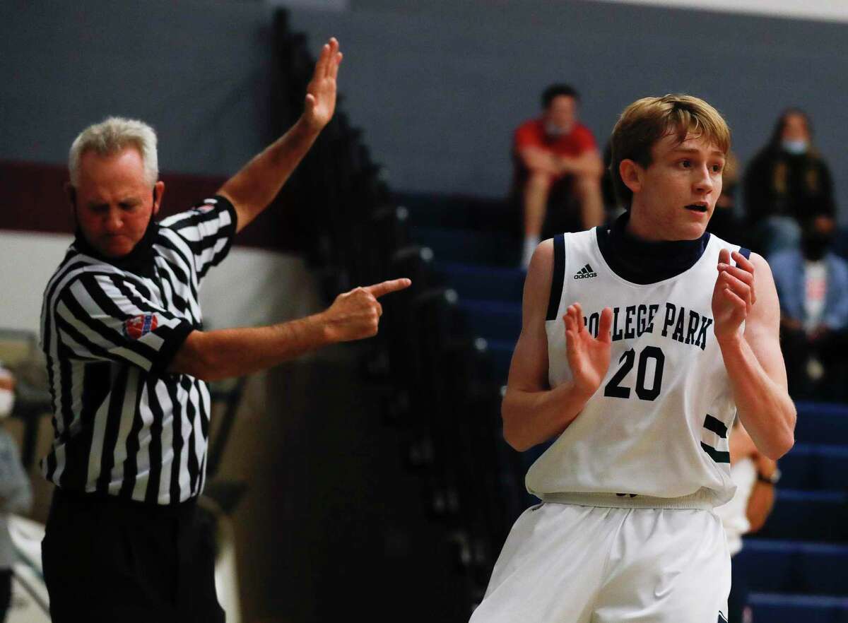 FILE PHOTO - College Park guard Jackson Mathias (20) reacts after a turnover by The Woodlands during the first quarter of a District 15-6A high school basketball game at College Park High School, Saturday, Jan. 23, 2021, in The Woodlands.