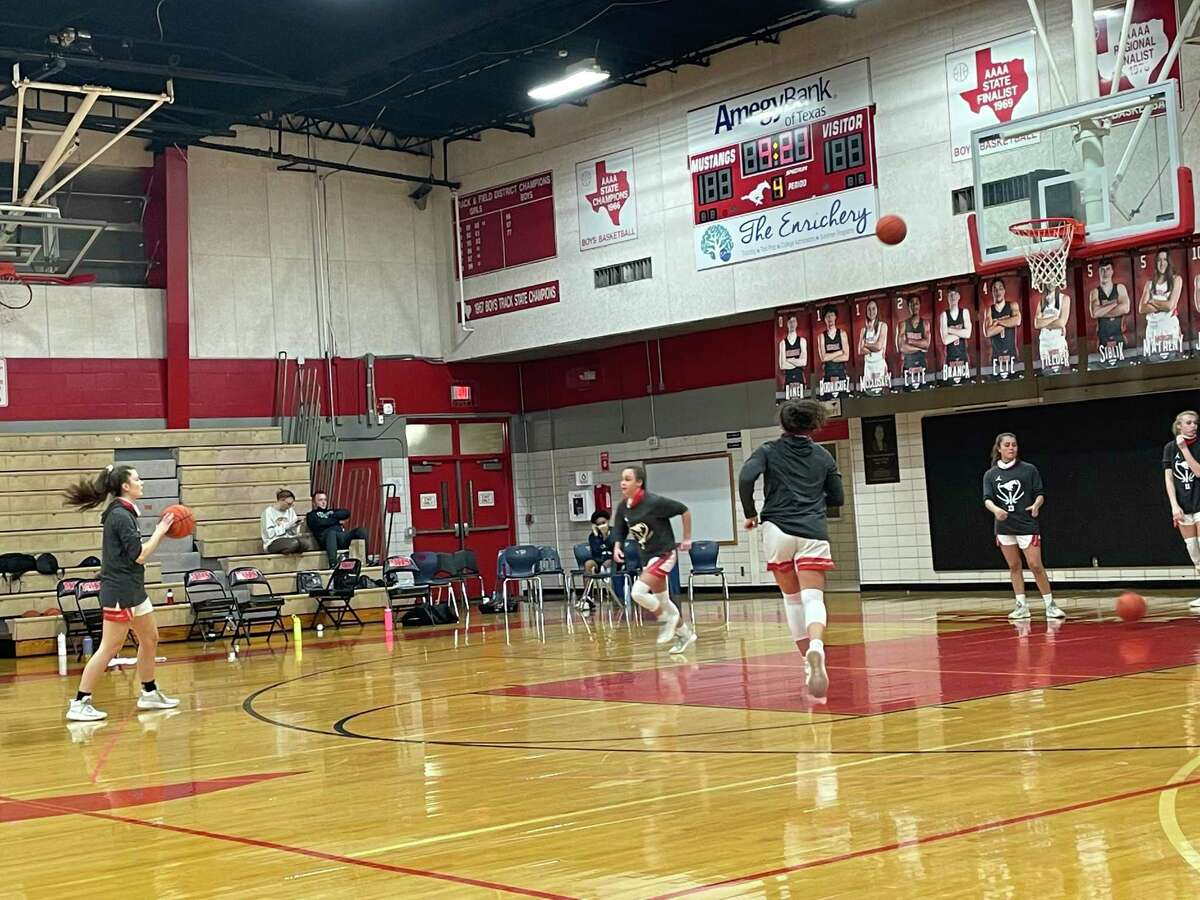The Memorial Lady Mustangs warm up before their regular season finale against Cy Ridge at Memorial High School on Feb. 5