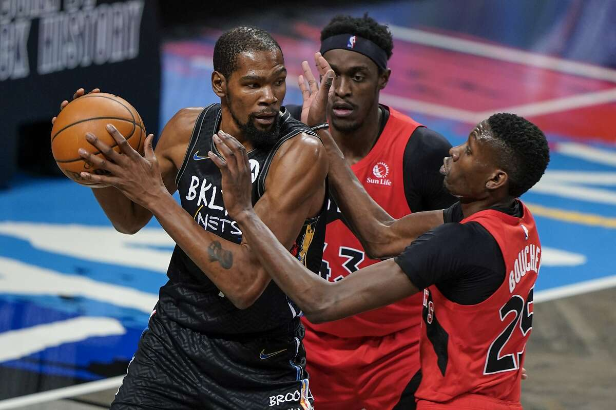Kevin Durant (left) had eight points before being pulled in the third quarter of the Nets' win over the Raptors.