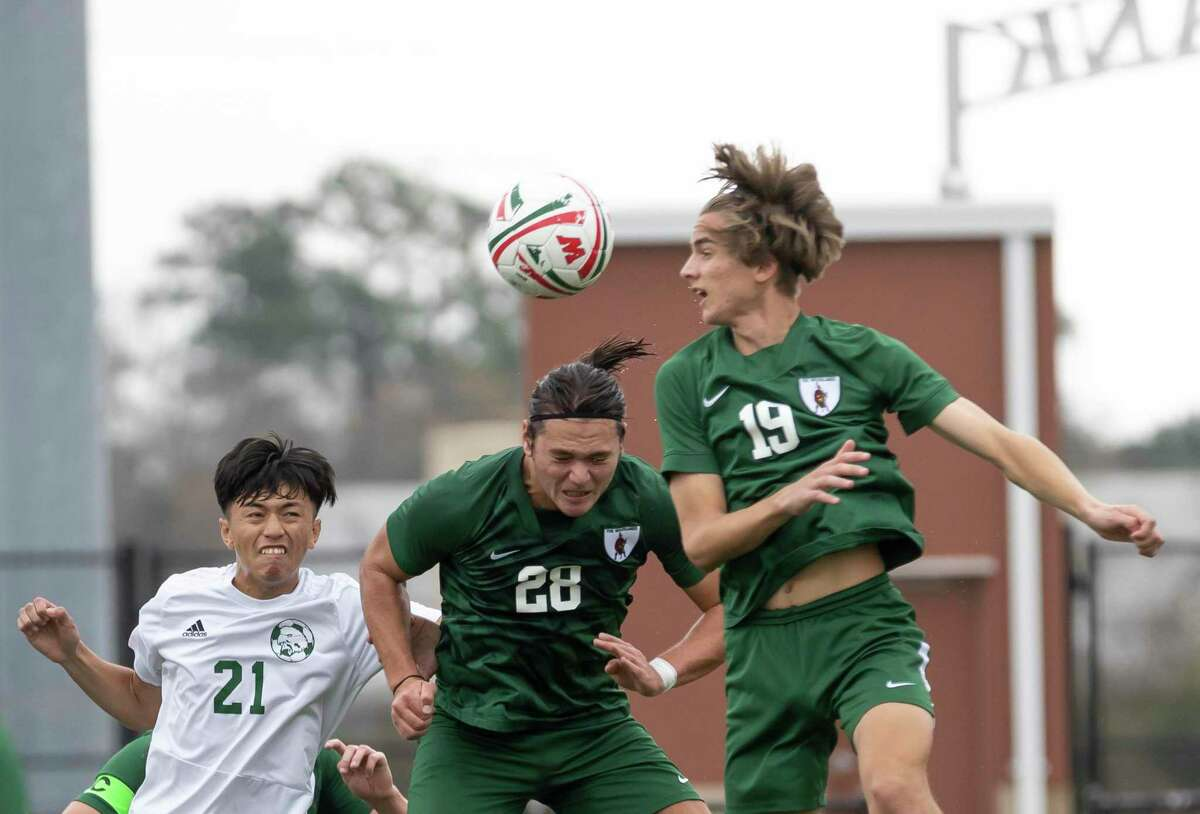 FILE PHOTO - The Woodlands defensive midfielder Davin Hickman-Chow hits the ball with his head during the first half of a Highlander Invitational soccer match against Klein Forest at Woodforest Bank Stadium, Friday, Jan. 22, 2021, in Shenandoah.