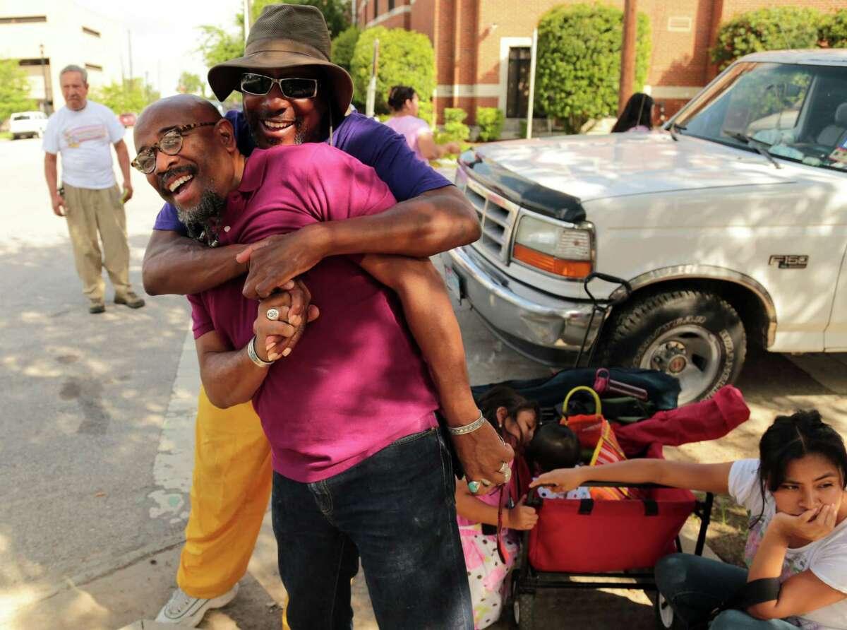 Church volunteer Maesto Tom Jones gives Pastor Rudy Rasmus a big hug at St. John's United Methodist Wednesday July 2, 2014 in Houston TX. (Billy Smith II / Houston Chronicle)
