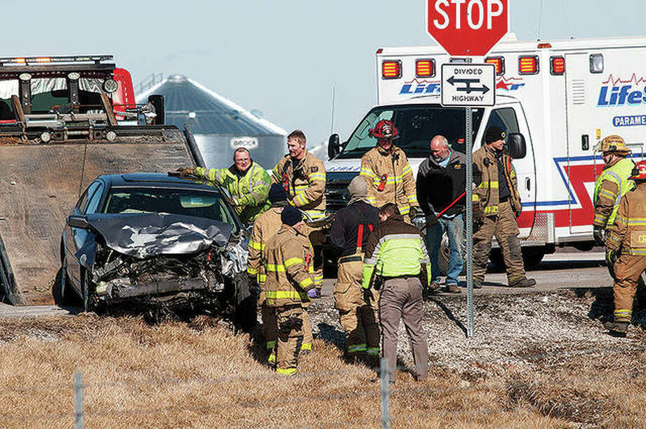 Three people were taken Friday to Passavant Area Hospital after a two-vehicle collision at U.S. 67 and Bethel Lane. Chapin firefighters and rescue personnel were assisted by Jacksonville firefighters and Morgan County sheriff's deputies. Photo: Darren Iozia | Journal-Courier