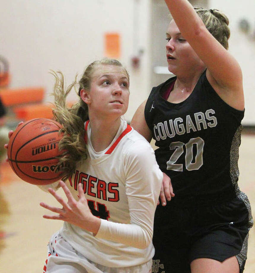 Greenfield's Alexis Pohlman, left, scored 16 points to lead the Tigers past Carlinville Friday night. She is shown in action last season against West Central. Photo: File Photo