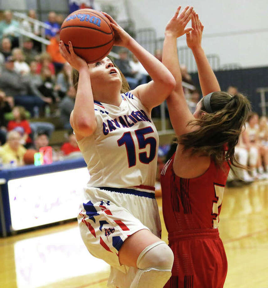 Carlinville's Gracie Reels (15), shown putting up a shot in a game last season, led all scorers with 16 points Friday night, but it was not enough to beat the Greenfield Tigers in a nonconference girls basketball game in Carlinville. Photo: Greg Shashack / The Telegraph