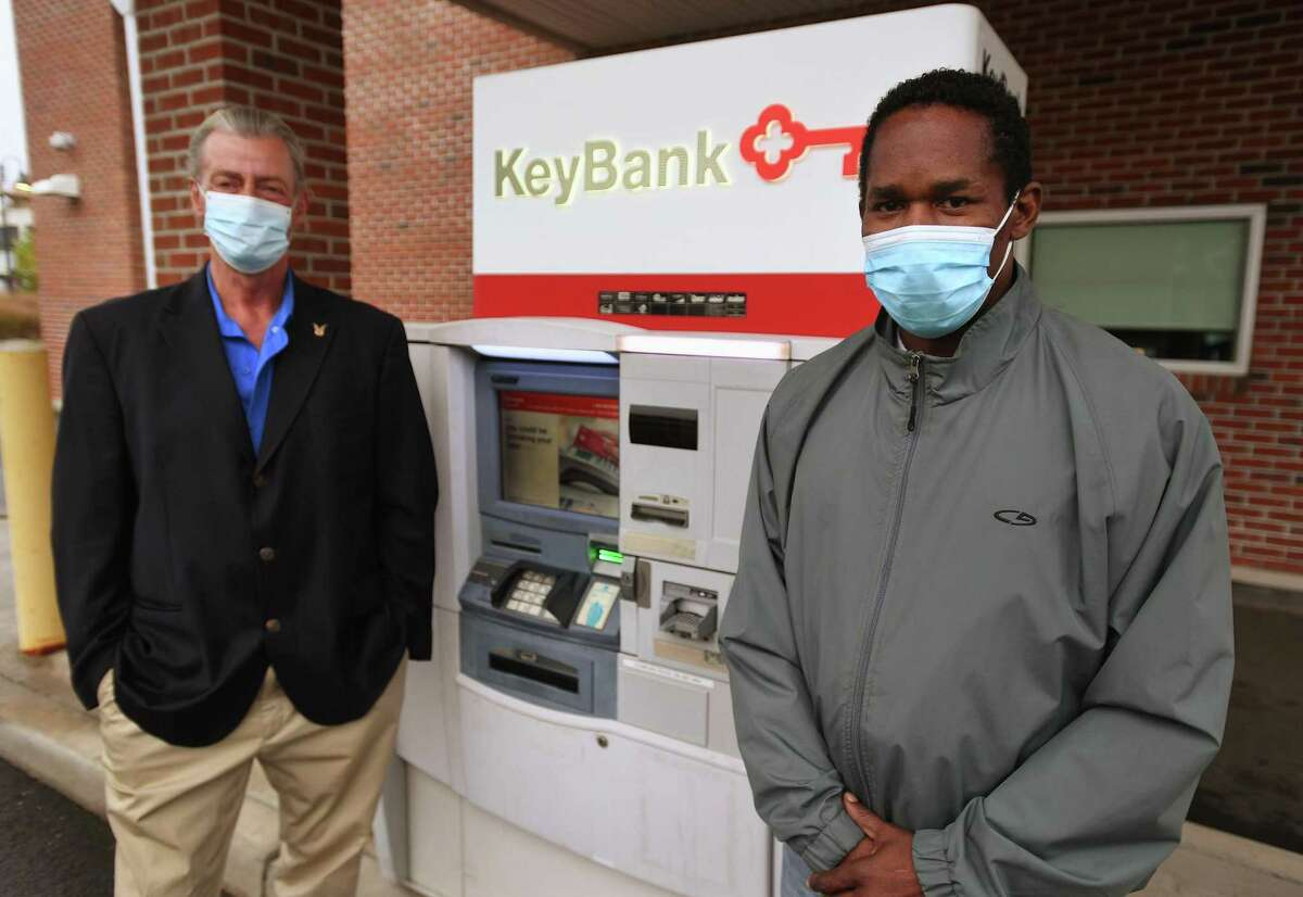 Leon Standly, left, and Kenneth Moss at the Key Bank on Canal Street in Stamford, Conn. on Monday, October 12, 2020. Standly, a Pacific House Shelter resident, helped Moss get a hassle free account at the bank after developing a relationship with a bank manager.